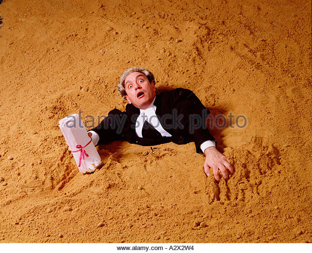 legal-profession-concept-barrister-sinking-in-sand-a2x2w4